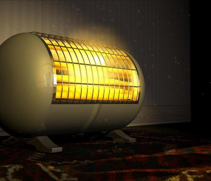cylindrical space heater on a carpet