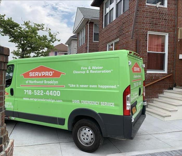 SERVPRO Vehicle backed up to unit for work