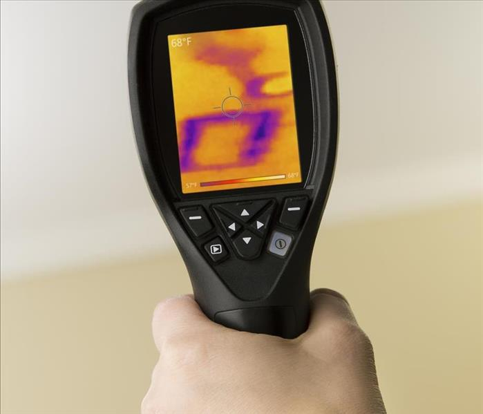 thermal camera held pointing at a wall