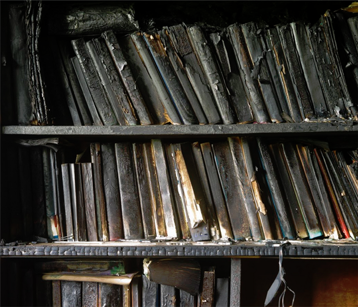 soot covered books on a shelf