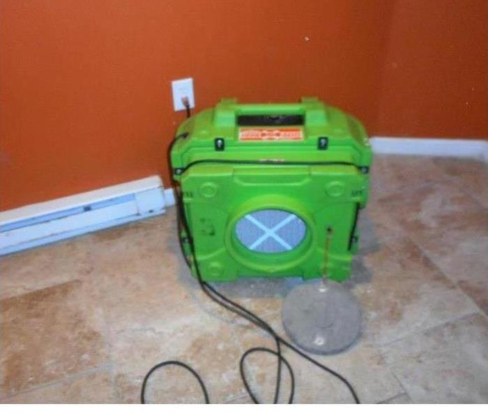 Our drying equipment drying the carpet in this home after a water loss incident